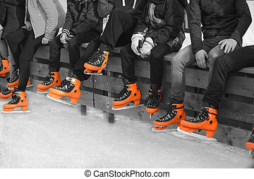 Teenagers in orange skate