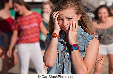 Teenagers Laughing at Scared Girl - Mixed group of young ...