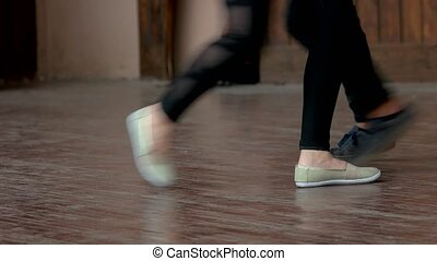 Teenagers legs dancing, close up.