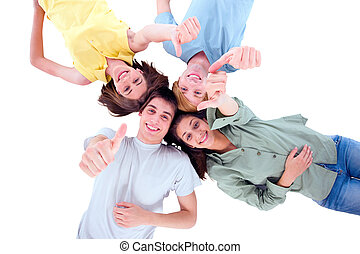 teenagers lying down with thumbs up