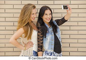 Teenagers making a selfie