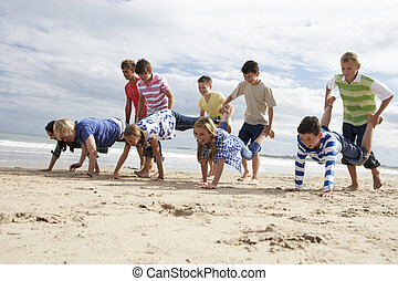 Teenagers playing on beach