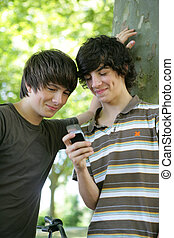 Teenagers playing with cellphone