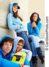 Teenagers - Portrait of several teens looking at camera ...