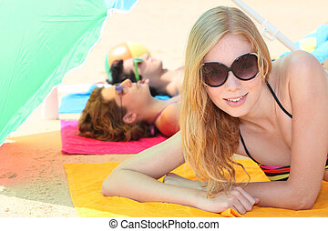 Teenagers relaxing on the beach