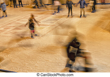 Teenagers skating on the ice rink
