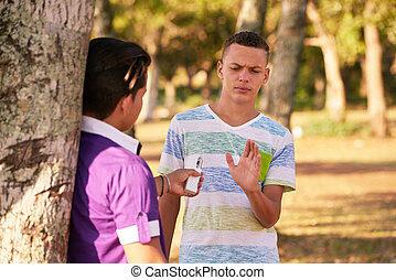 Teenagers Smoking Boy Refusing To Smoke E-cig
