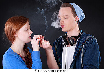 Teenagers smoking marijuana joint - Horizontal view of a...