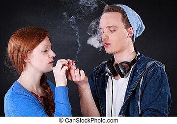 Teenagers smoking marijuana joint - Horizontal view of a ...