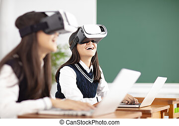 teenagers student with virtual reality headset in classroom