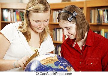 Teenagers Study Globe