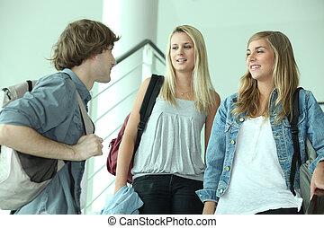 teenagers talking in stairs
