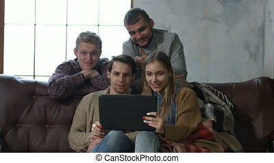 Teenagers talking online in video call with tablet