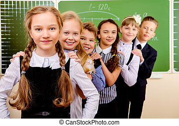 teenagers uniform - Happy schoolchildren at a classroom. ...