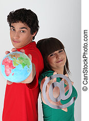 Teenagers with a globe and an @ symbol