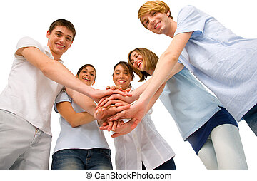teenagers with hands together