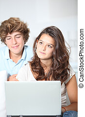 Teenagers with laptop computer