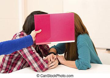 Teengage student couple enjoying some privacy