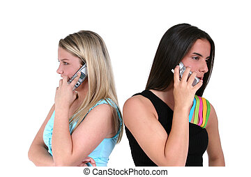 Teens And Cellphones - Two teens back to back speaking on...