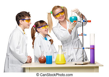 Teens and teacher of chemistry at lesson making experiments...