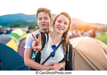 Teens at summer festival - Beautiful young couple at summer ...