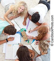 Teens doing homework together