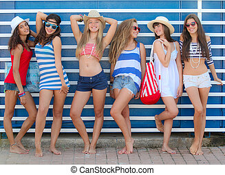 teens girls in beach wear at summe vacation or spring break