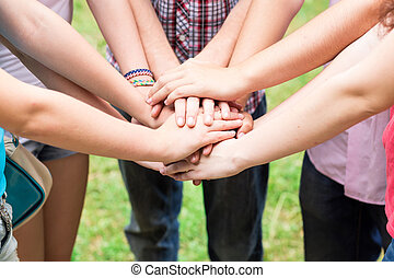 Teens' hands toghether