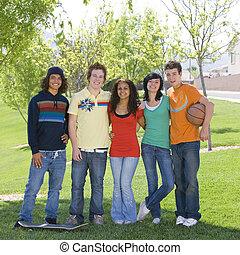 Teens hang out at park - Five teens hang out at park