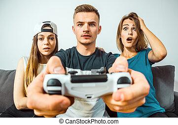 Teens Having Fun Playing Video Game