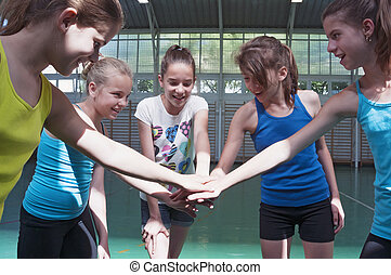 Teens in gymnasium - Young women in gym hands in position