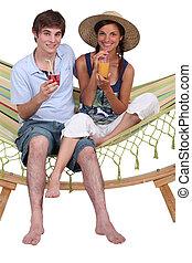 Teens in hammock