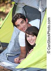 Teens in tent