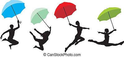 Teens jumping with umbrella