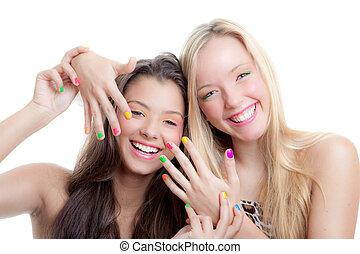 teens nails, young girls with bright make up and nail varnish