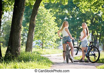 Teens on bicycles