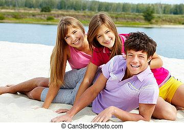 Teens on the beach - Portrait of three teenage friends on...