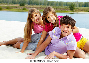 Teens on the beach - Portrait of three teenage friends on...