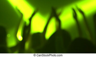 Teens on the dancefloor in color music dance on concert. Silhouette. Slow motion