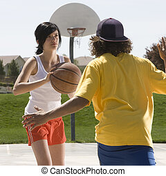 Teens play basketball