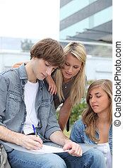 Teens taking notes