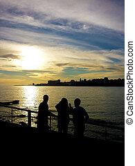Teens Watching the Sunset