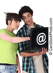 Teens with black computer
