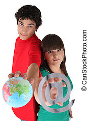 Teens with globe and at sign