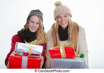 teens with wrapped gifts for christmas or party