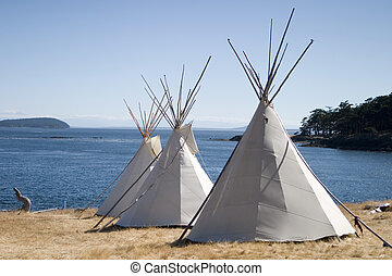 Teepee Camp By Water - Three teepees (aka tipis) are lined...