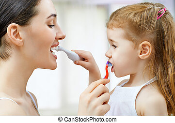 teeth brushing - mother and daughter brush my teeth