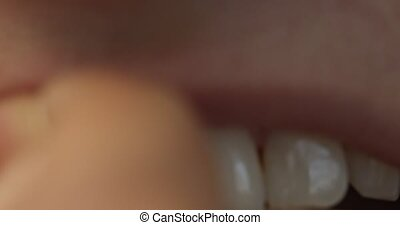 Teeth cleaning ang oral hygiene - The close view of woman...