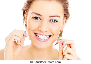 Teeth flossing - A picture of beautiful woman flossing her...