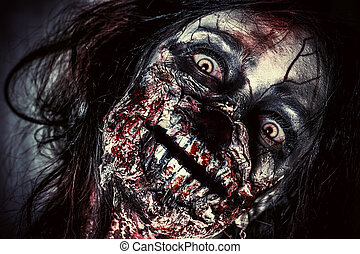 teeth in blood - Close-up portrait of a scary bloody zombie...